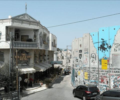Banksy's 'Scar of Bethlehem' unveiled at Walled Off Hotel