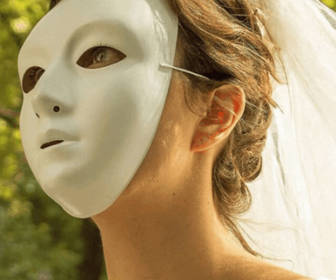 The Masked Bride reveals identity with new exhibit on domestic abuse